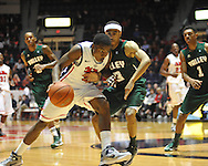 Mississippi's Jarvis Summers (32) dribbles against  Mississippi Valley State's Darryl Marshall (3) in Oxford, Miss. on Friday, November 9, 2012. (AP Photo/Oxford Eagle, Bruce Newman)