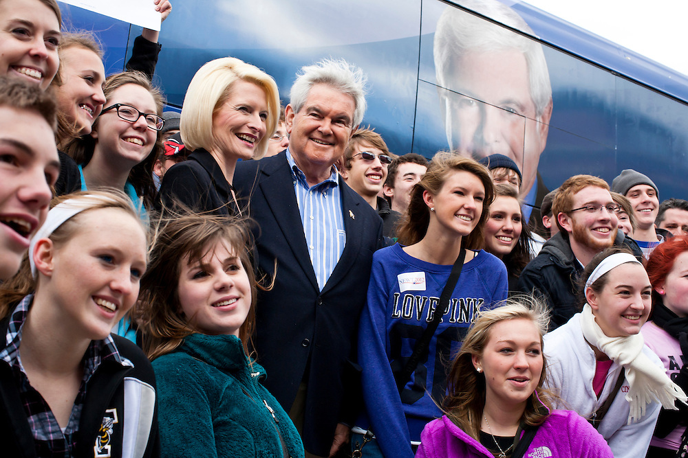 Republican presidential candidate Newt Gingrich poses for a photo with students outside the West Towne Pub on Sunday, January 1, 2012 in Ames, IA.