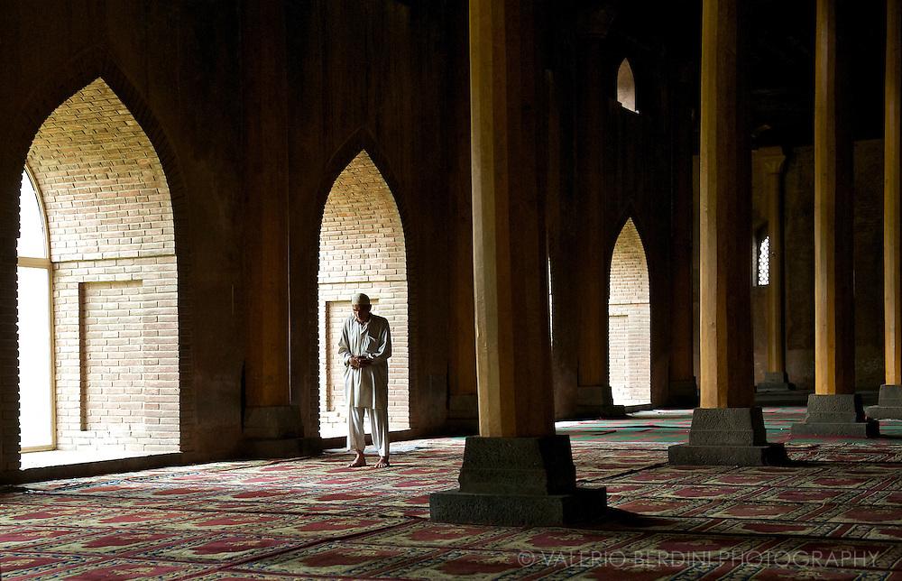 A Muslim man prays in the Jamia Masjid, the biggest Mosque of Srinagar.