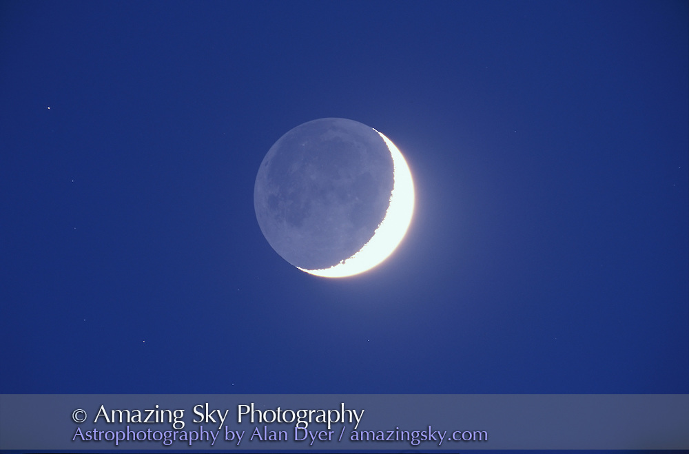 Earthshine on waxing crescent Moon, March 21, 1999<br /> <br /> 5-inch apo refractor at f/6<br /> Ektachrome 100 slide film<br /> Exposure about 15 seconds, in bright sky<br /> <br /> In series with 3 others in order of darkening sky.