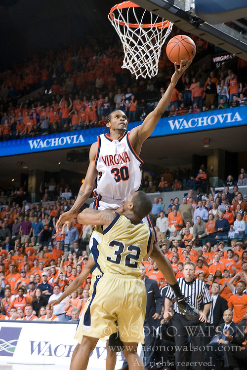 Virginia Cavaliers forward Adrian Joseph (30) shoots over Georgia Tech Yellow Jackets Forward Jeremis Smith (32).  Joseph was called for a charge on the play.  The Virginia Cavaliers Men's Basketball Team defeated the Georgia Tech Yellow Jackets 75-69 at the John Paul Jones Arena in Charlottesville, VA on February 24, 2007.