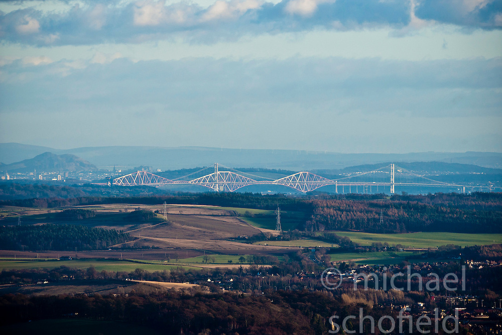 View of both bridges over the River Forth, Arthurs Seat, Edinburgh Castle and the Lothian from the slope of the Dumyat, a hill at the western extremity of the Ochil Hills, in central Scotland..Pic © Michael Schofield...
