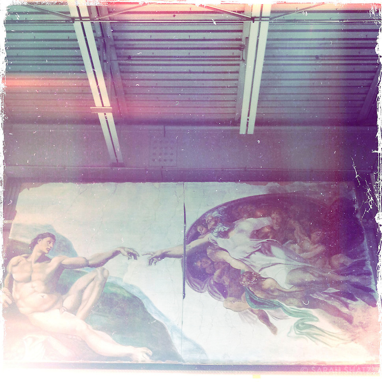 The Creation of Adam, Michelangelo's fresco on the Sistine Chapel ceiling, reproduced at Chelsea Piers