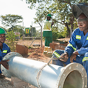 CAPTION: Knowledge and Pio weld pipes for the Bindagombe Irrigation Scheme. As of May 2016, construction of the project is almost complete. LOCATION: Mawoneke Village, Chivi District, Masvingo Province, Zimbabwe. INDIVIDUAL(S) PHOTOGRAPHED: Knowledge Cent (left) and Pio Gudo (right).