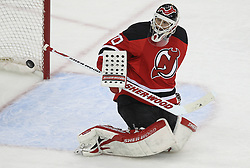 April 24, 2012; Newark, NJ, USA; New Jersey Devils goalie Martin Brodeur (30) makes a save during the third period of game six of the 2012 Eastern Conference quarterfinals at the Prudential Center.
