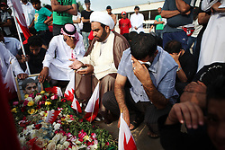 """In the early morning hours of Saturday, November 19, protesters say their 16-year-old comrade Ali al-Badah was run over by a police SUV in the village of Juffair. He was buried in his family's hometown of Sitra, where thousands of mourners attended a funeral march on Tuesday marking an end to the three-day mourning period. Protesters chanted they would """"redeem"""" the """"martyr"""" and for the downfall of the al-Khalifa regime. After 15-20 minutes, they were met by riot police who fired teargas and rubber bullets."""