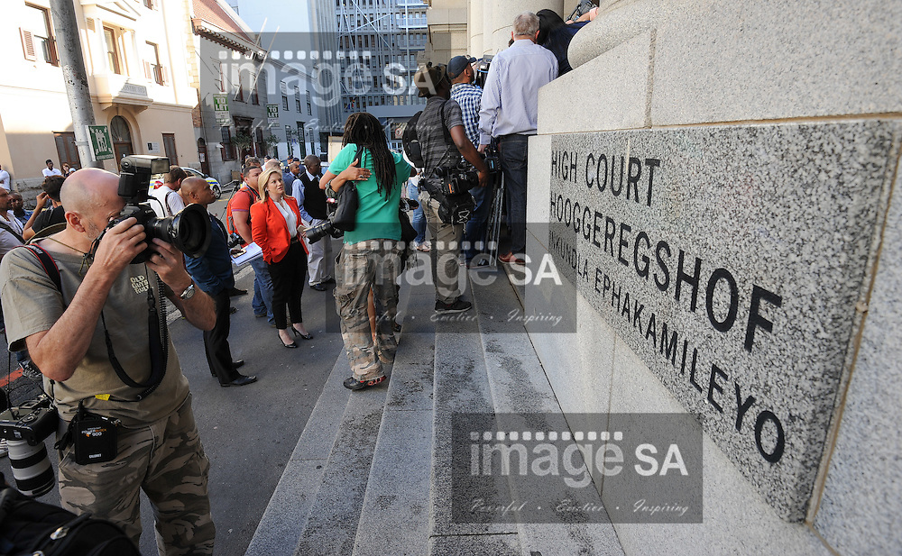 CAPE TOWN, SOUTH AFRICA - Monday 6 October 2014, photographers outside the High Court during Day 1 of the Shrien Dewani trial at the Cape High Court before Judge Jeanette Traverso. Dewani is caused of hiring hit men to murder his wife, Anni. Anni Ninna Dewani (n&eacute;e Hindocha; 12 March 1982 &ndash; 13 November 2010) was a Swedish woman who, while on her honeymoon in South Africa, was kidnapped and then murdered in Gugulethu township near Cape Town on 13 November 2010 (wikipedia).<br /> Photo by Roger Sedres