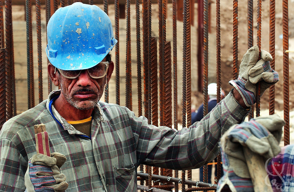 "Iraqi construction workers lay concrete during March 09, 2004 work on the Sharkh Dijlah (""East of the Tigris"") water treatment plant in east Baghdad.  One of two major water treatment plants serving the Iraqi capital's 4.72 million residents, the Sharkh facility is currently undergoing a 15.2 million dollar expansion project funded by USAID and supervised by the Bechtel corporation that will increase potable water flow to eastern Baghdad by some 45% when it is completed later this year."