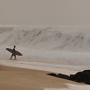 surfer walking on the beach,surf photos