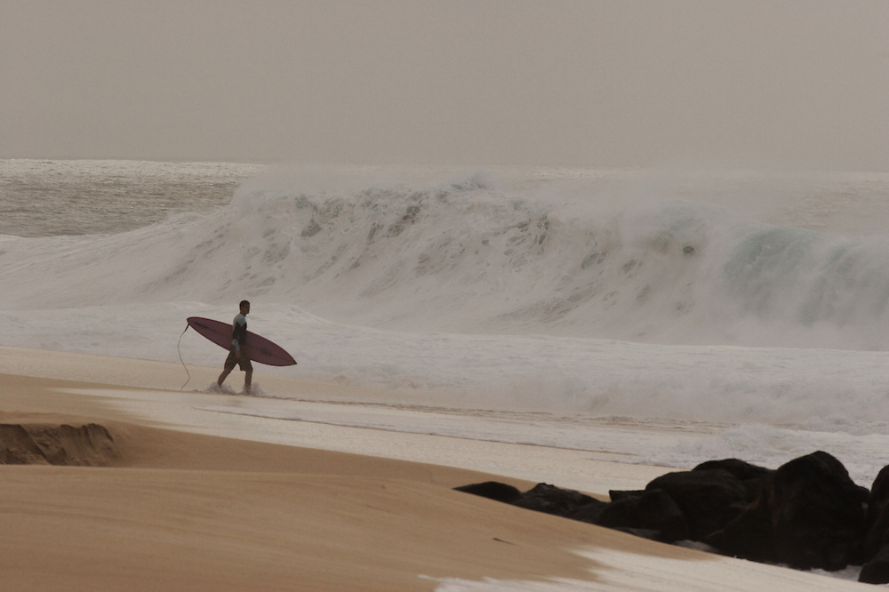 surfer walking on the beach,surf photos