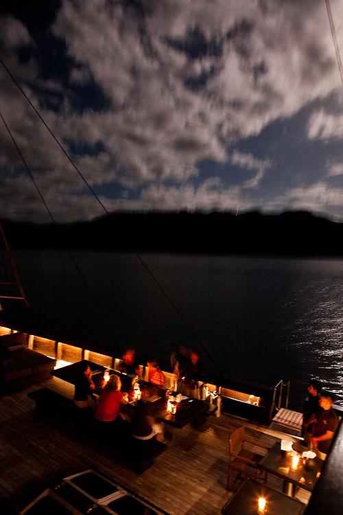 Dinner on deck in the full moom on Alila Purnama.