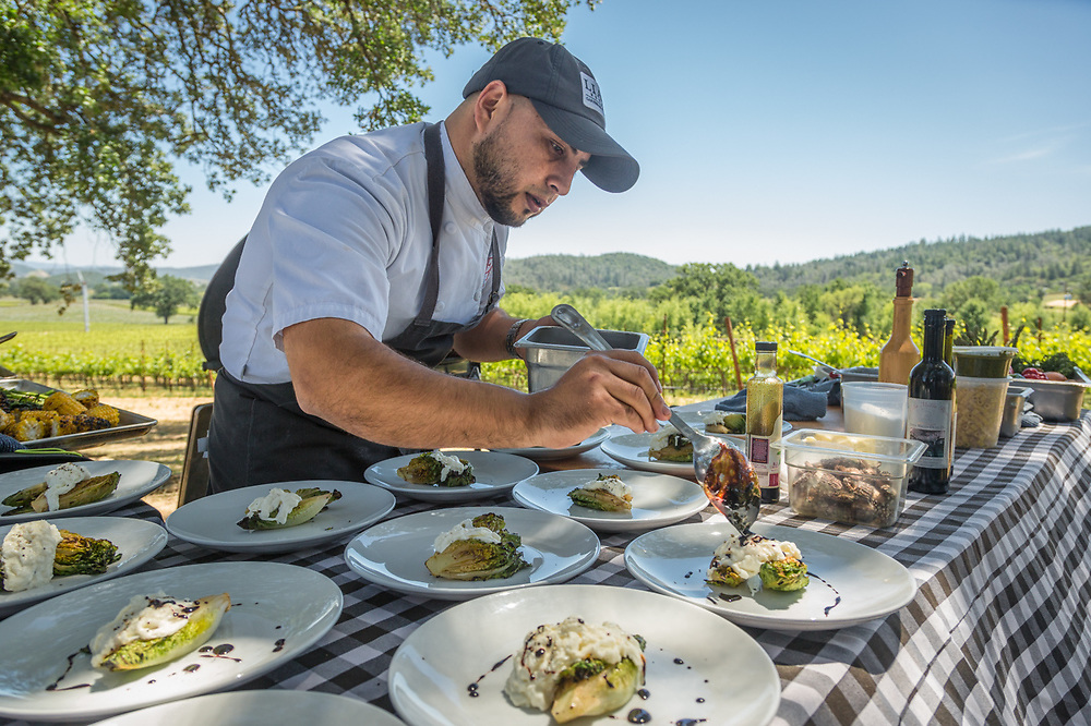 Executive Chef Alex Espinoza prepares food for a wine country familiarization trip for visitor industry professionals at Peju Winery in Pope Valley.