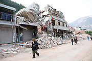 Local return to Beichuan to retieve any possible possesions not detraued during the earthquake.