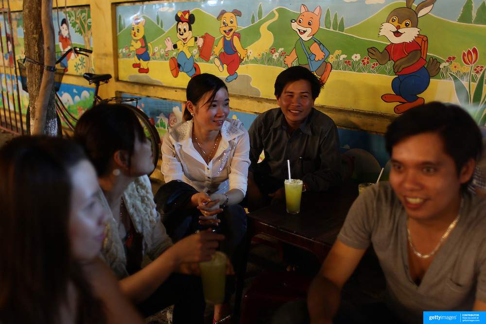 Locals drink on a street corner in Hoi An, Vietnam. Hoi An is an ancient town and an exceptionally well-preserved example of a South-East Asian trading port dating from the 15th century. Hoi An is now a major tourist attraction because of its history. Hoi An, Vietnam. 5th March 2012. Photo Tim Clayton