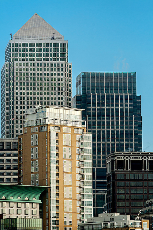 Canary Wharf, the financial heart of London pictured against a clear blue sky