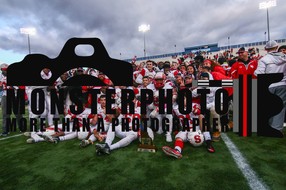 Smyrna (12-0) players pose picture with the championship trophy after winning their second straight DIAA division one Football Championship defeating Top-seeded Middletown (11-1) 36-14 Saturday, Dec. 03, 2016 at Delaware Stadium in Newark.