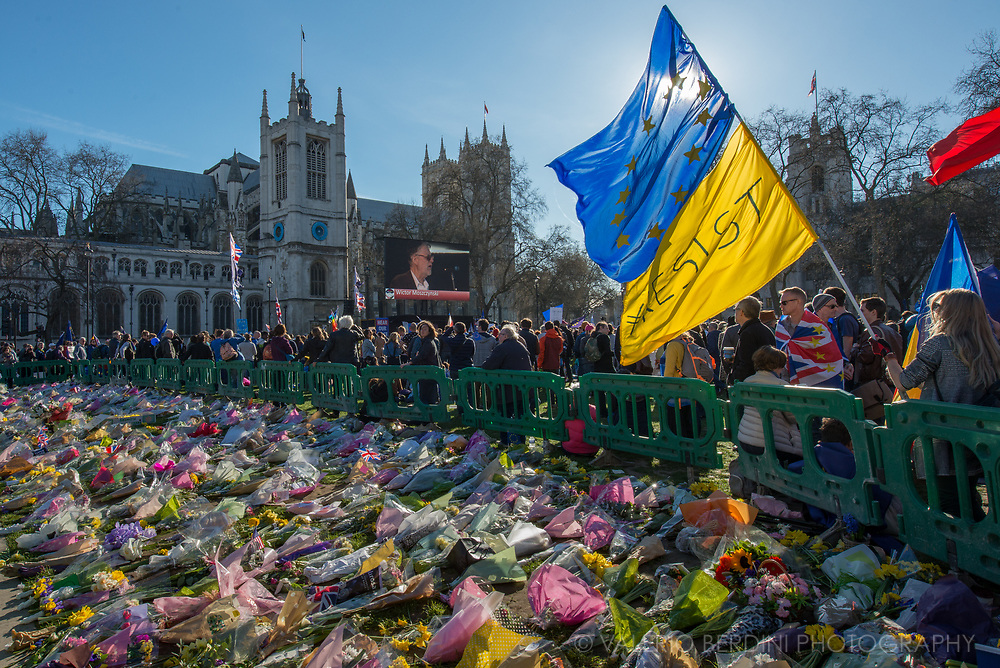 Flowers donate by people attending the March for Europe left in Parliament square where the crowd stopped to listen to pro-EU politicians speaking.