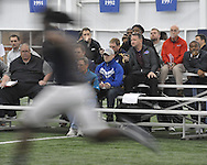 Pro football scouts time the 40 yard dash at Ole Miss Pro Day at the Indoor Practice Facility in Oxford, Miss. on Thursday, March 7, 2013.