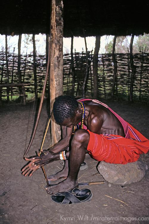 Africa, Kenya, Maasai Mara. Demonstration of starting a fire.