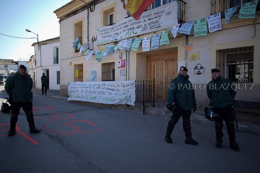 Spanish Civil Guards protect the city council building during a demonstration organized by environmentalists against the possible construction of a nuclear waste storage in Villar de Cañas, near Cuenca , on February 12, 2012. Banner read slogans in favor of the nuclear waste storage.