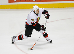 April 26, 2007; East Rutherford, NJ, USA; Ottawa Senators defenseman Joe Corvo (7) takes a shot that beats New Jersey Devils goalie Martin Brodeur (30) during the first period at Continental Airlines Arena in East Rutherford, NJ.