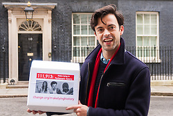 """Downing Street, London, January 7th 2015. TV star 2015-01-07 TV star Jolyon Rubinstein delivers a """"Make Lying in Parliament History"""" petition with 111,913 signatures to 10 Downing Street. The petition aims """"to start a debate about the importance of the truth in politics"""" and comes off the back of his satirical TV show The Revolution Will be Televised which has been """" highlighting the corruption, greed and hypocrisy in our system"""" and wants to make lying in Parliament a criminal offence. PICTURED: Jolyon Rubinstein outside 10 Downing Street"""