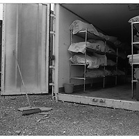 Bodies awaiting identification or reburial are stored in white body bags and cardboard boxes in refrigerated storage containers in Pristina, Kosovo