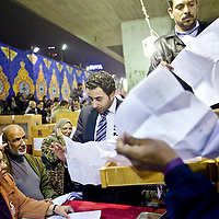 Egyptian election officials begin counting ballots at a collection center for ballot boxes in Cairo on Tuesday after a second day of voting in Egypt's parliamentary elections. November 2011.