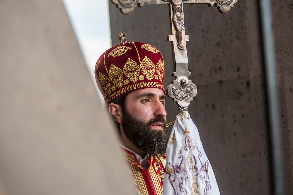 VAGHARSHAPAT, ARMENIA - APRIL 23: A member of the Armenian Apostolic Church participates in a canonization ceremony for victims of the Armenian genocide at the Mother See of Holy Etchmiadzin, a complex that serves as the administrative headquarters of the Armenian Apostolic Church, on April 23, 2015 in Vagharshapat, Armenia. Tomorrow will mark the one hundredth anniversary of events generally considered to be the start of a campaign of genocide against minority ethnic Armenians living in present-day eastern Turkey by the Ottoman government over fears of their allegiance during World War I. (Photo by Brendan Hoffman/Getty Images) *** Local Caption ***