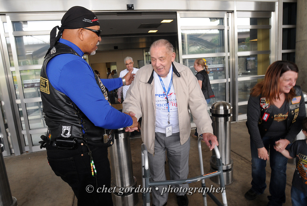 WASHINGTON, DC.  WWII Veterans and their escorts during the arrival ceremony at Reagan National Airport prior to visiting the World War II Memorial in Washington, DC and Arlington National Cemetery in Arlington, VA on Saturday, September 21, 2013.  © www.chetgordon.com