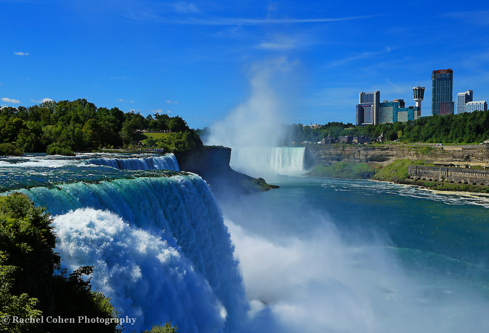 &quot;Niagara Falls on a Clear Day&quot;<br /> <br /> Gorgeous powerful scene of both the American and Canadian side of Niagara Falls on a bright clear day!!<br /> <br /> Waterfalls by Rachel Cohen