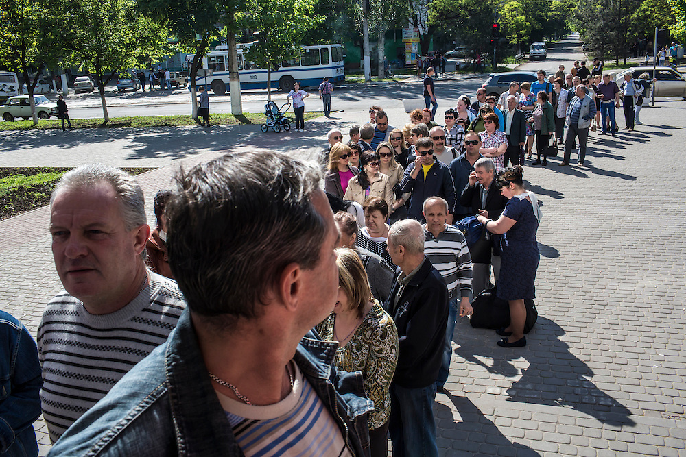 MARIUPOL, UKRAINE - MAY 11: People stand in line to cast their ballots at a polling station on May 11, 2014 in Mariupol, Ukraine. A referendum on greater autonomy is being held after pro-Russian activists took over at least ten cities in the eastern part of the country. (Photo by Brendan Hoffman/Getty Images) *** Local Caption ***