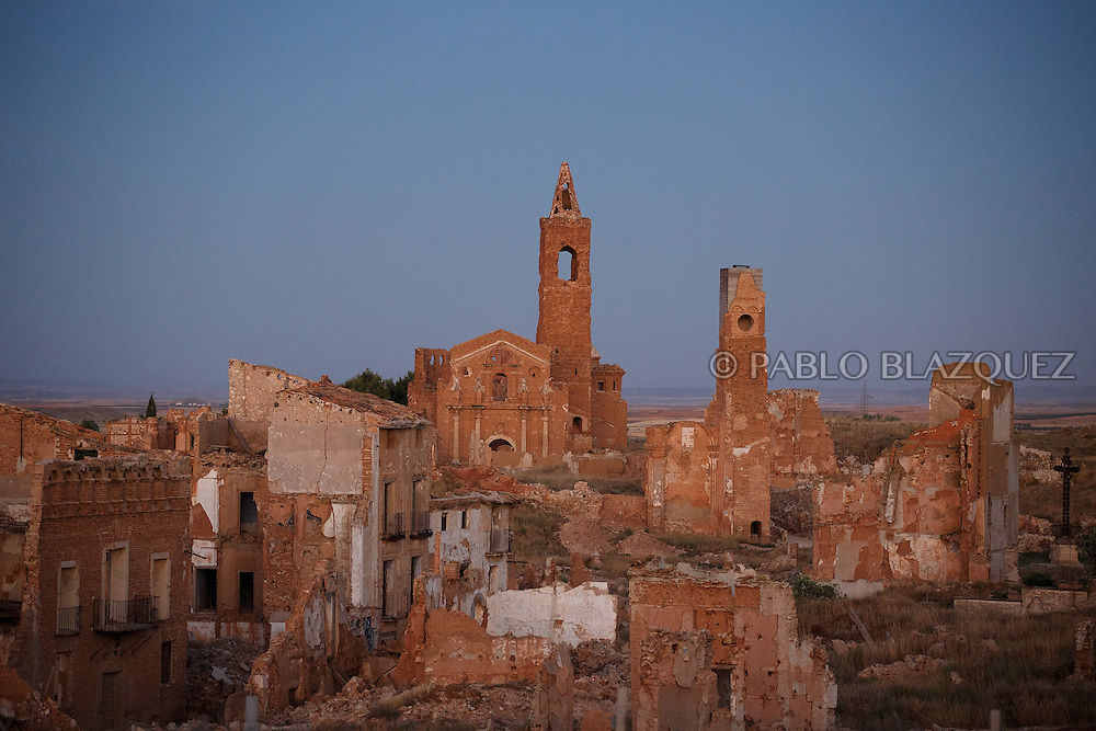 14/07/2016. The ruins of San Martin de Tours church and other houses stand on July 14, 2016 at Old Belchite village, in Aragon province, Spain. Before Franco's coup on 18 July 1936, Belchite village had a socialist mayor. Within a few days Franco's forces arrested Belchite's government. The battle of Belchite took place on 24 August to 7 September 1937, during the Spanish Civil War confronting left wing Republicans and right wing General Franco's forces, until the Republicans conquered the village. On March 1938, Franco's regime took control of Belchite again after approximately 30 bombings with the help of Italian's war planes. The result of these battles and bombings was a devastated village and over three thousands deaths. Then Franco ordered to leave the ruins untouched, as a living monument of war, and started to build the New Belchite village just beside. (© Pablo Blazquez)