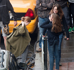 """Day two filming. Brad Pitt's co-star Mireille Enos on the set of the movie """"World War Z"""" being shot in the city centre of Glasgow. The film, which is set in Philadelphia, is being shot in various parts of Glasgow, transforming it to shoot the post apocalyptic zombie film.."""