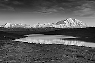 Alpenglow on Denali (Mt. McKinley) and the Alaska Range with Wonder Lake in foreground in Denali National Park in late fall in Southcentral Alaska. Evening.