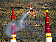 Master pilot Nicolas Ivanoff of France severs a pylon on the Red Bull Air Race course placing sixth in the qualifying round at the Las Vegas Motor Speedway.
