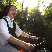 Sister Kathleen O'Neill buzzes around the convent in a 2X4 Gator, donated to the sisters for use on their expansive grounds near the Mississippi River.  Our Lady of the Mississippi Abbey is a monastery of Trappist nuns.  The community of 22 Roman Catholic women follow Jesus Christ through a life of prayer, silence, simplicity and ordinary work.  Their home is a beautiful monastery which sits high on a bluff, overlooking the Mississippi River.