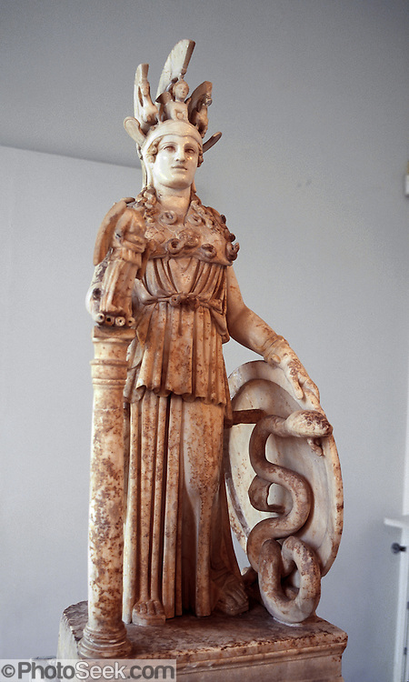 """In the National Archaeological Museum in Athens, Greece, see a Roman model of the """"Athena Polias"""" (""""Athena of the city"""") sculpture which was placed in the Parthenon in 432 BC, originally 12 meters high. Athena (Athene or Athina) has Nike in her right hand, and sphinx and griffins in her headpiece. Greeks built the Parthenon atop the Acropolis in 447-438 BCE as a place to worship goddess Athena and also as a treasury to store tribute money moved from Delos Island. The Greek philosopher, Plato (429347 BC), identified Athena with the Libyan deity Neith who was the war goddess and huntress deity of the Egyptians since the ancient Pre-Dynastic period, and who was also identified with weaving. Athena is the virgin patron of her namesake city Athens, and is goddess of wisdom, courage, inspiration, civilization, law and justice, just warfare, mathematics, strength, strategy, the arts, crafts, and skill. Minerva, Athena's Roman incarnation, embodies similar attributes."""