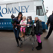 The Makohoniuk Family of Waukee, Iowa, (L-R) Maksim, age 8 months; Tara, mom; Ella, 4.5 years old; Sam, 2 years old; Brooke, 11 years old, pose for photos in front of former Gov. Mitt Romney (R-MA) campaign bus after a rally Friday, December 30, 2011, in West Des Moines, IA.  The family was grocery shopping at the store where the rally was held...Photo by Khue Bui