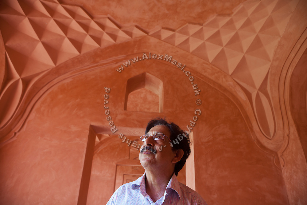 R.K. Dixit, the senior government conservator at the Taj Mahal  complex in Agra is standing near a recently restructured part of the red sandstone exterior of the Taj Mahal complex.