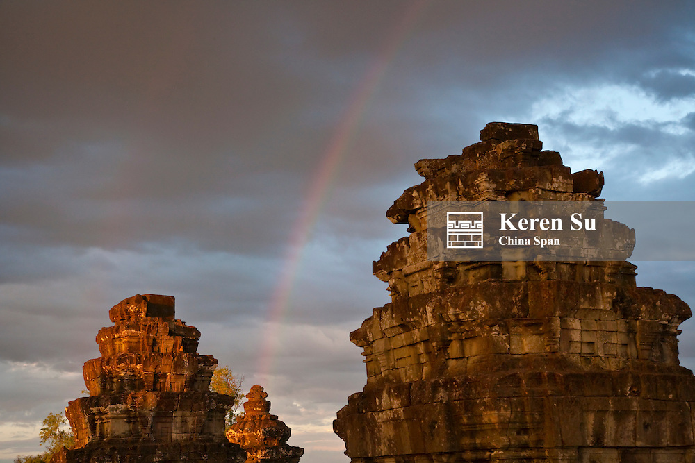 Ruins on Bakheng Hill at sunset with rainbow, UNESCO World Heritage site.