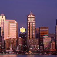 WA10053-01...WASHINGTON - Moon rise over downtown Seattle and Elliott Bay from West Seattle.