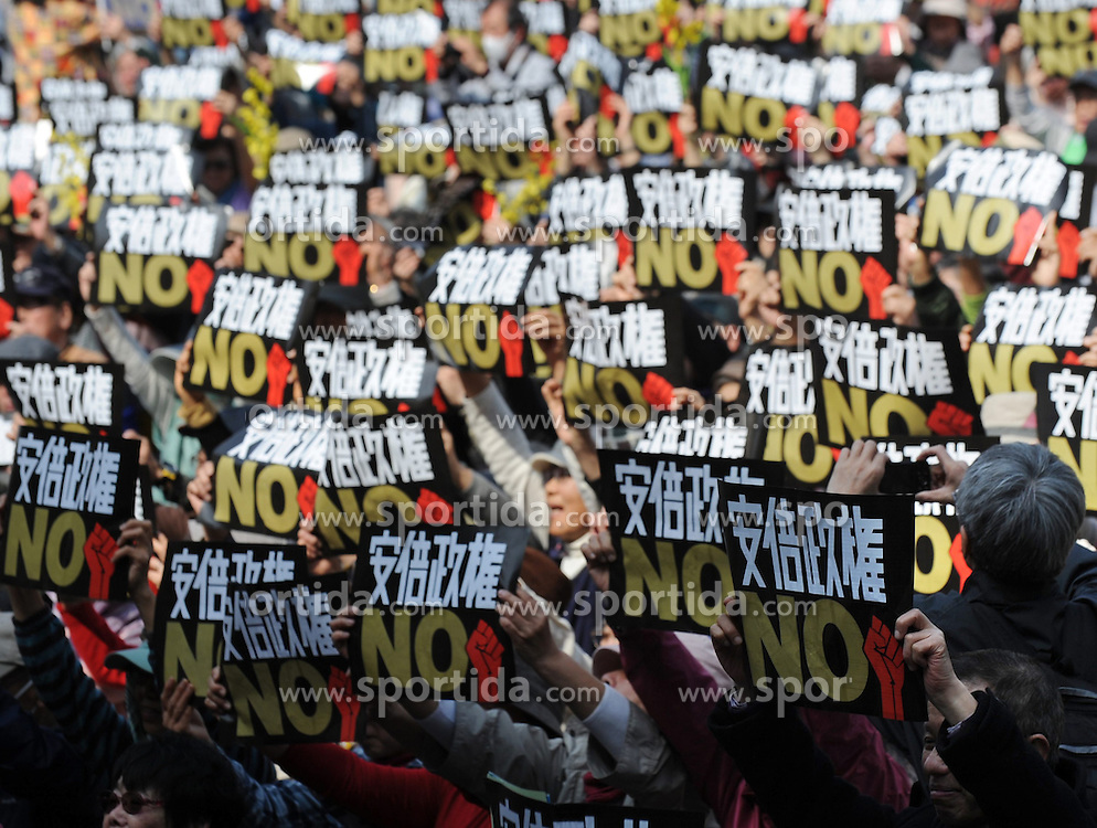 People hold placards during a demonstration against Japanese Prime Minister Shinzo Abe in Tokyo, Japan, March 22, 2015. EXPA Pictures &copy; 2015, PhotoCredit: EXPA/ Photoshot/ Stringer<br /> <br /> *****ATTENTION - for AUT, SLO, CRO, SRB, BIH, MAZ only*****