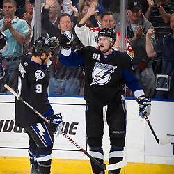 TAMPA, FL - MARCH 2:  Steven Stamkos #91 of the Tampa Bay Lightning celebrates his goal with teammate Steve Downie #9 during the first period against the Philadelphia Flyers at the St. Pete Times Forum on March 2, 2010 in Tampa, Florida. (Photo by Scott Audette/NHLI via Getty Images) *** Local Caption *** Steven Stamkos;Steve Downie