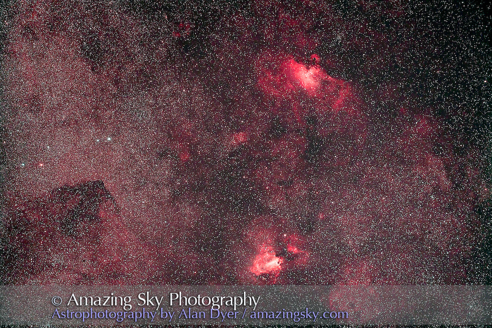 Messier 16 (Eagle Nebula, top) and Messier 17 (Swan or Omega Nebula, bottom), shot from home in southern Alberta with the objects low on the horizon, July 30, 2011. This is a stack of 5 x 5 minute exposures at ISO 1600 with the filter-modified Canon 5D MkII and the Borg 77mm f/4.3 astrograph lens (300mm focal length), and using the IDAS V nebula filter.