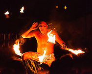 A master fire-knife dancer pauses to goad the crowd during The Grand Luau at Honua'ula, luau at the Waldorf-Astoria Grand Wailea Resort in south Maui.