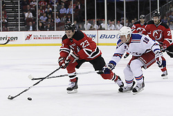 Mar 25, 2010; Newark, NJ, USA; New Jersey Devils right wing David Clarkson (23) and New York Rangers defenseman Marc Staal (18) race for the puck during the first period at the Prudential Center.