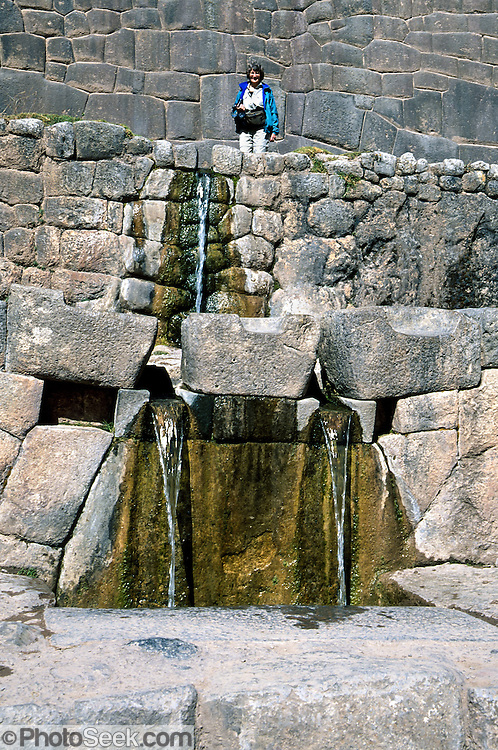 "Around 1450 AD, the Incas diverted a spring through impressive stone work and waterfalls at the archaeological site of Tambomachay (El Baño del Inca), 8 km north of Cuzco, in Peru, South America. Tampumachay means ""collective housing resting place"" in Quechua language. The Incas perfected stonecraft to an amazing degree."