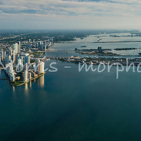 Downtown Miami and surrounds from the air at sunrise.  This version is watermarked, contact us to license and clean version.