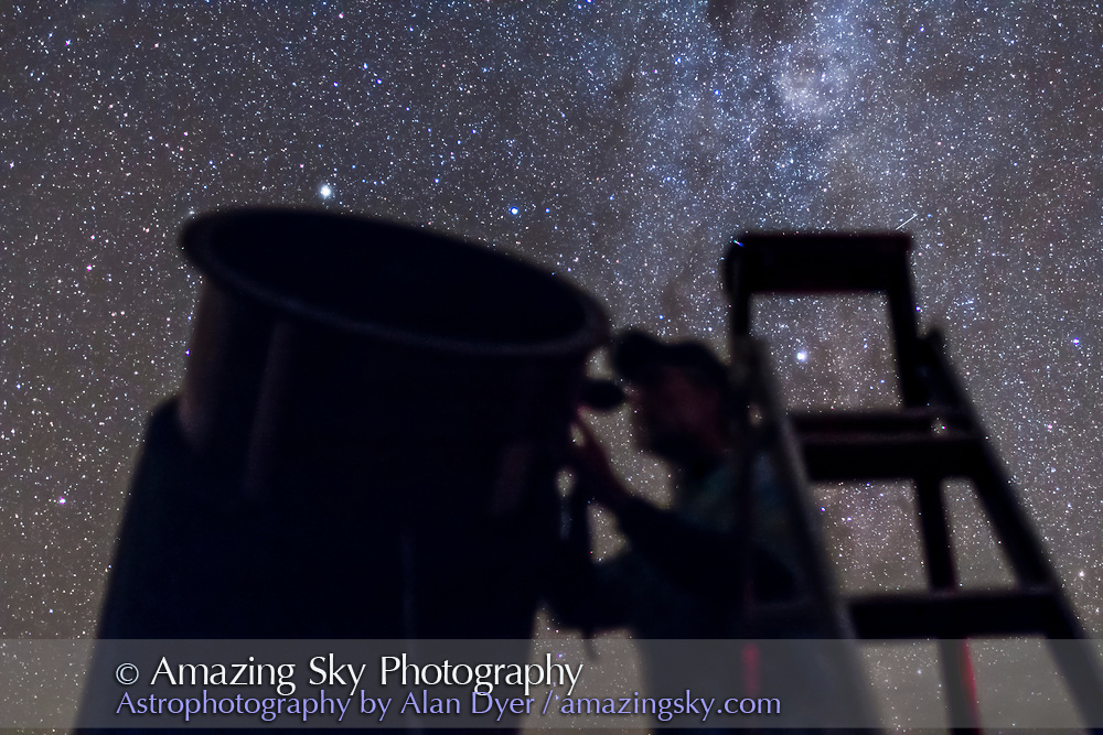 An observer gazing into the southern stars with a large reflector telescope at the 2014 OzSky Star Safari star party near Coonabarabran, NSW, Australia, March 2014. <br /> <br /> This is a single untracked 10-second exposure at f/1.4 with the 35mm lens and Canon 60Da at ISO 3200.